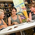 Photo of three woman studying together in a library