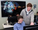 Photo of five university students in a computer lab, playing games