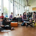 A photo of a group of Flinders university students hanging out in a university space, u...