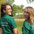 Image of two James Cook University Get into Uni ambassadors wearing their green uniform...