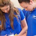 Two female Souther Cross University students working together in a medical setting