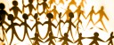Image of paper cut out people in brown tones, making a connection