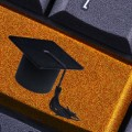 An image of a mortar board on a keyboard key