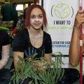 Image of three Indigenous students sitting cross legged in front of the Make Your Mark ...