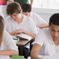 Image of a group of high school students in class, working