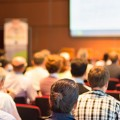 Image of an audience attending a research forum