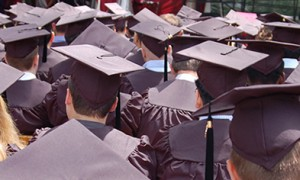 Image of a group of university graduates wearing regalia at a graduation ceremony