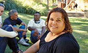 Image of Indigenous University Students sitting on lawn