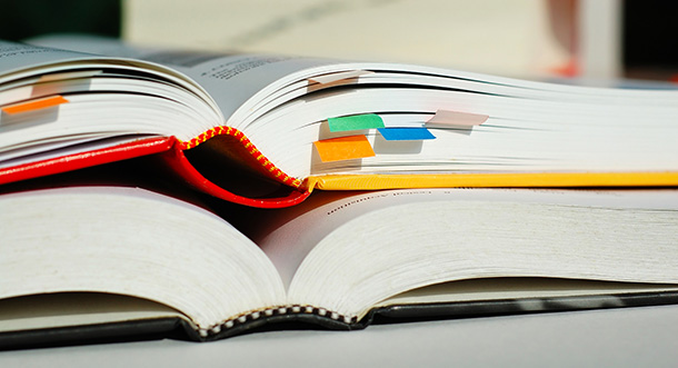 Image of two open textbooks on a desk