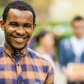 Image of a university student on campus smiling