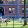 Blurred image of university students on campus and outdoors