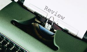 Typewriter with Review text