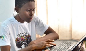 Student using a laptop computer at home during COVID