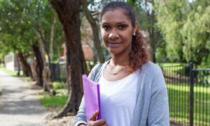 Indigenous woman holding a folder